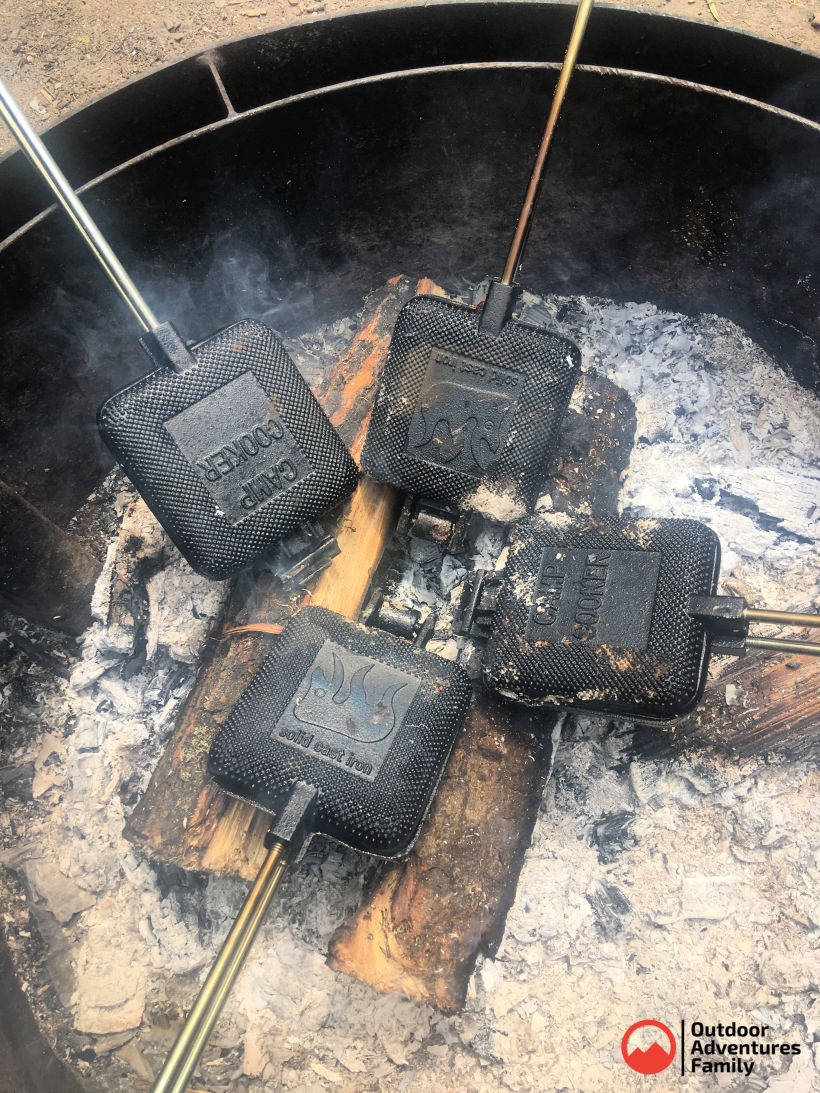 pie irons in campfire